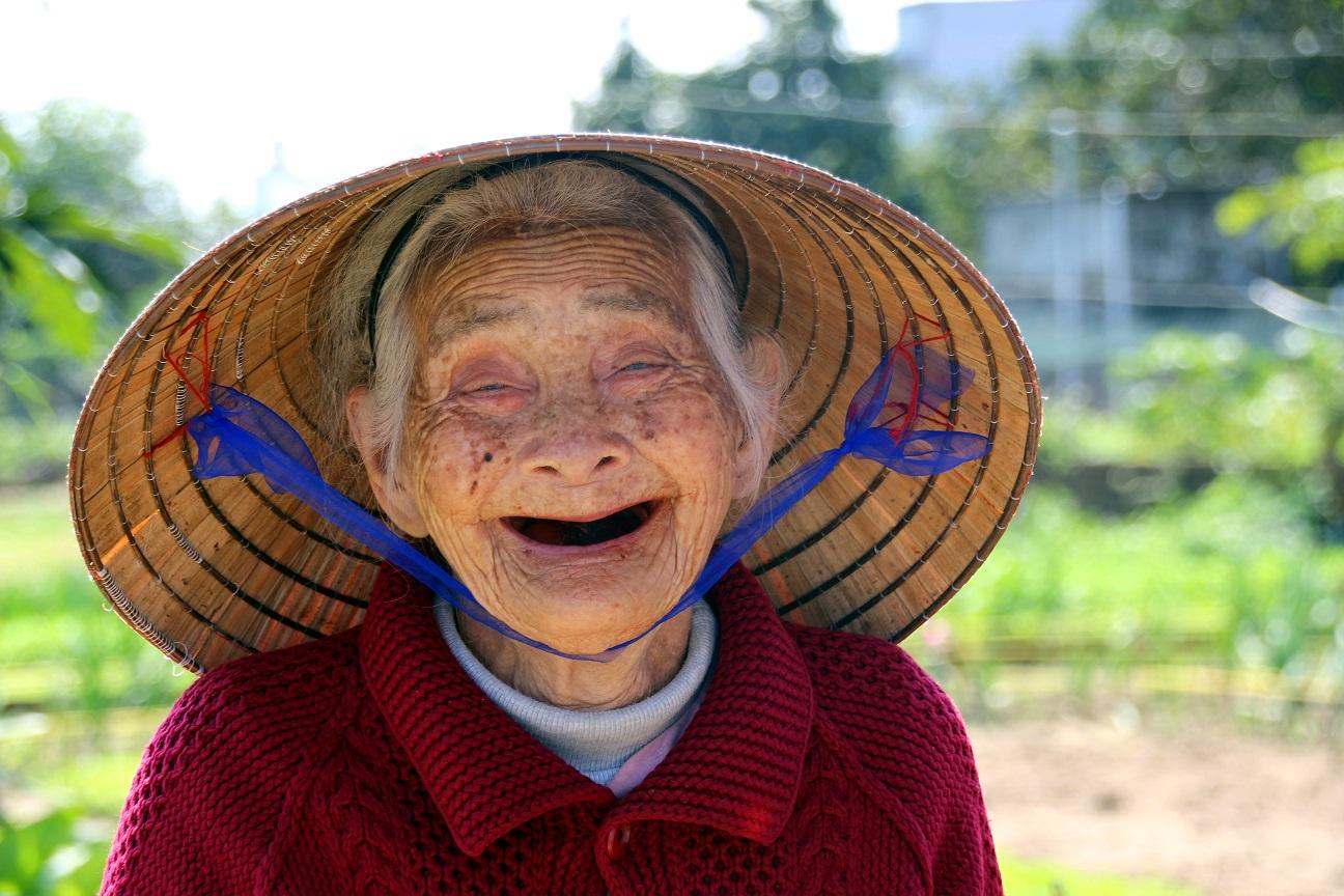 Lachende vietnamesische Dame Bild